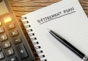 bigstock-Retirement-Plan-Concept-Calcu-299445301